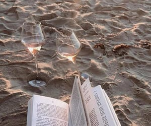 book, wine, and beach image