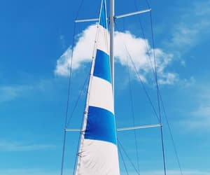 blue, blue and white, and sail boat image