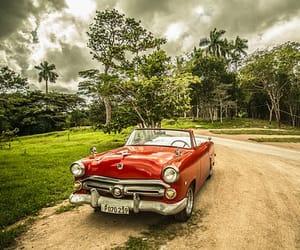 car, red, and dirt road image
