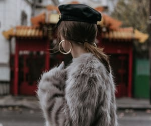 fur, statement earring, and captain hat image