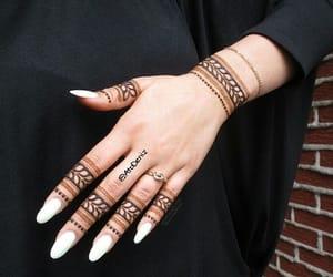 nails and tattoo henna image