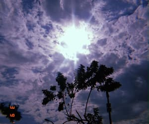 blue sky, lights, and sun image