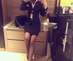 british airways, flight attendant, and legs image
