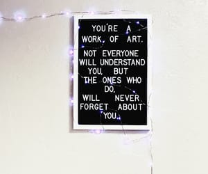 letter board, fairy lights, and quote image