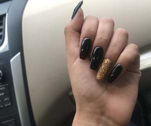 black, golden, and nails image
