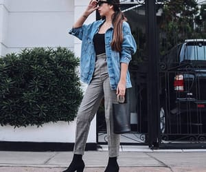 black boots, jeans, and jean jacket image