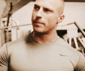 bald, muscular, and fitness image