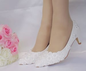 stiletto heels, pointed toe, and appliqués image
