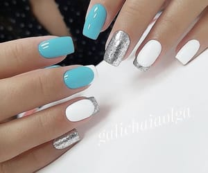 blue nails, white and blue nails, and glitter nails image