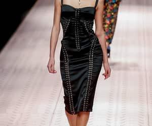 black dress, Black Eyeliner, and black heels image