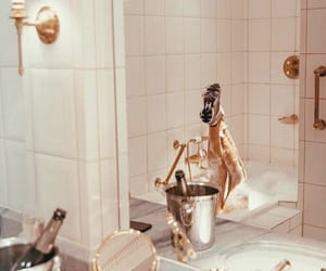 bathroom, sneakers, and champagne image