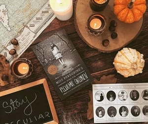 books, candle, and photo image