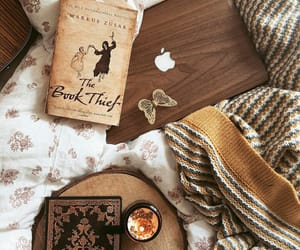 books, candle, and sweater image