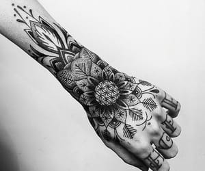 tattoo, hand, and flowers image