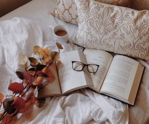 let's chill tonight! reading a book and drinking hot chocolate ☕📖 remember that I published my September Favourites article 🍁 love you