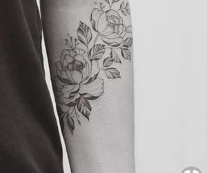 arm tattoo and flower tattoo image