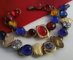 statement jewelry, red blue yellow, and martinimermaid image