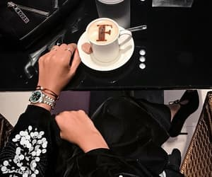 rolex and abaya image