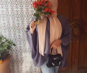 city, flowers, and hijab image