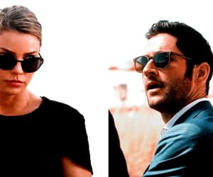 lauren german, tom ellis, and lucifer morningstar image