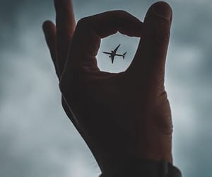 travel, hand, and plane image