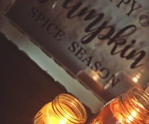 candles, pumpkin, and seasonal image