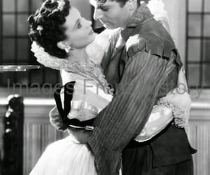 laurence olivier, vivien leigh, and fire over england image