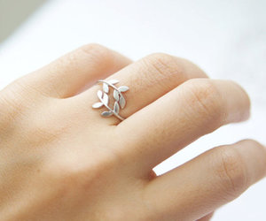 ring, leaves, and hand image