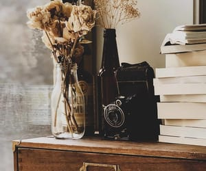 antique, books, and flowers image