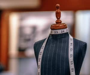 mannequin, measuring tape, and tailor image