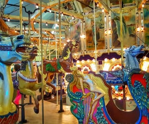 amusement park, horse, and merry go round image