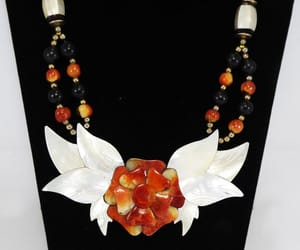 beaded necklace, flower necklace, and flowered image