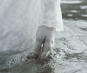 hand, wading, and water image