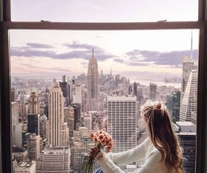 girl, city, and flowers image