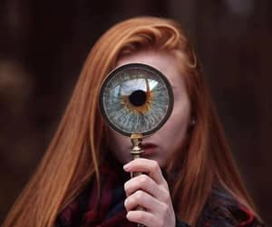 black red scarf, magnifying glass eye, and redhead eye image