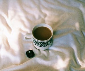 bed, cup, and drink image