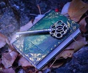 book, key, and magic image
