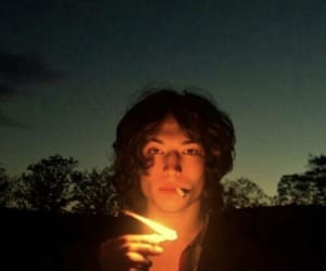 ezra miller, boy, and fire image
