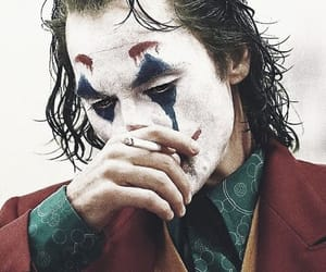 joaquin phoenix, joker, and the joker image