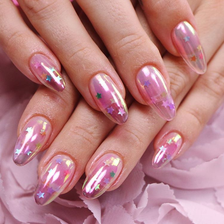 Jelly,holographic,pink nails with stars uploaded by AmandaLeveck