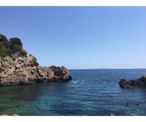 blue, ocean, and rocks image