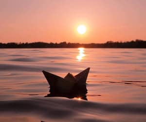 sun, sunset, and water image