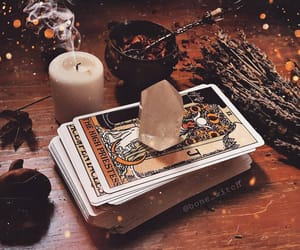 candle, crystal, and tarot image