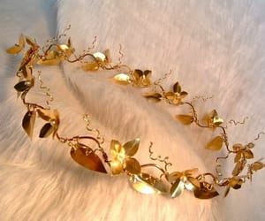 beige, gold, and laurel image