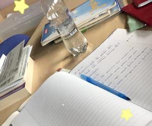 books, homework, and water image