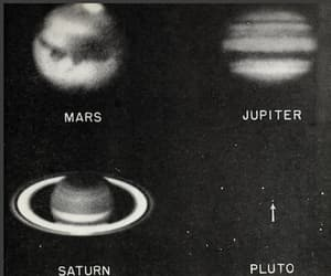 black and planets image