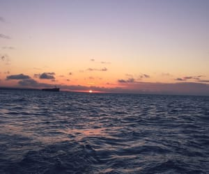 sea, sunset, and the ocean image