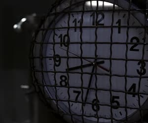 clock, dark, and evening image