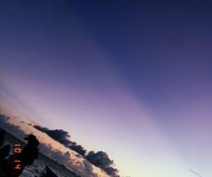 arena, palm trees, and sunrise image