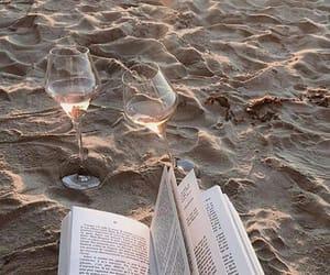 book, beach, and wine image
